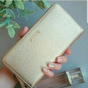 Kate spade wristlet wallet gold phone holder